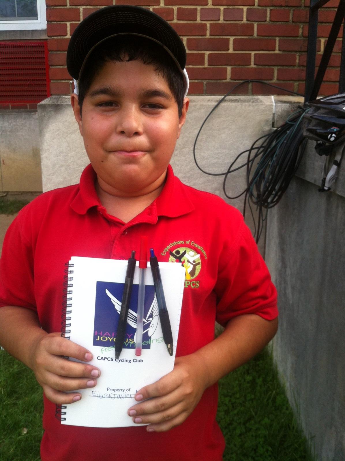 Boy with CAPCS bike club journal