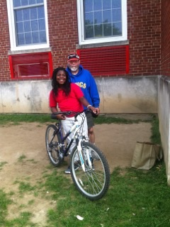 Fola and Dr. Sharpe on a tandem